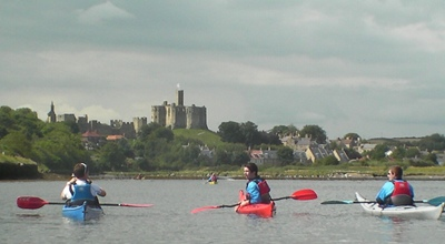 Paddling towards Warkworth Castle